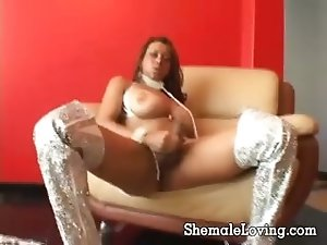 Sexy naughty shemale with an amazing tits masturbating on the sofa