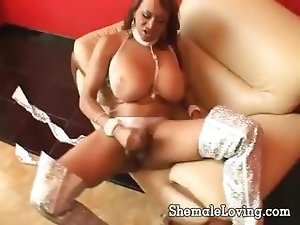 Big tit shemale stroking her dick