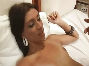 Brunette shemale gets fucked anally and cumme